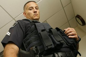 Officer Rubio shows off his new vest while demonstrating a choke hold for our unsuspecting photographer.