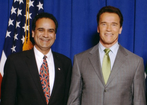Harry Sidhu poses with a near life-size dummy of Arnold