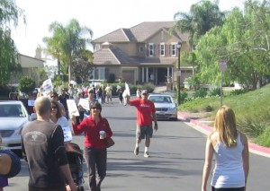 Teachers march on the home of CUSD Trustee Mike Winsten